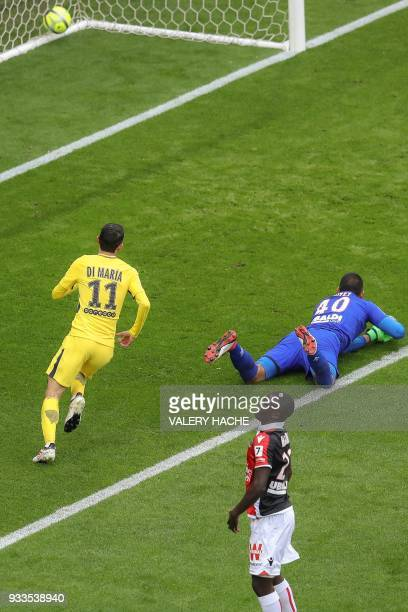 Paris SaintGermain's Argentinian forward Angel Di Maria scores an equalizer past Nice's Argentinian goalkeeper Walter Benitez during the French L1...