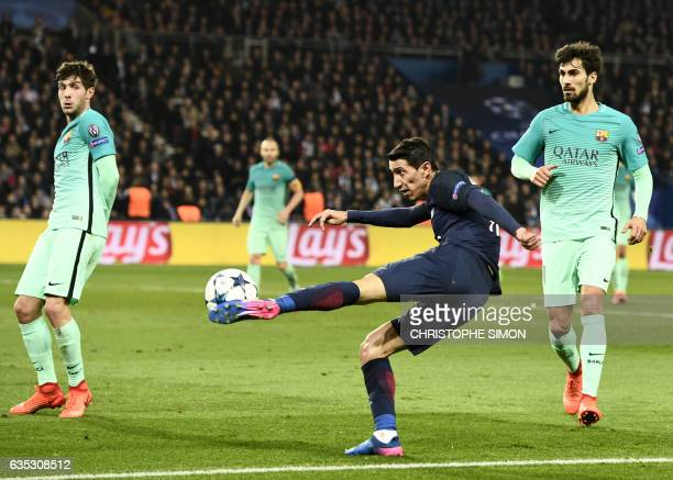 Paris SaintGermain's Argentinian forward Angel Di Maria shoots next to Barcelona's Portuguese midfielder Andre Gomes during the UEFA Champions League...