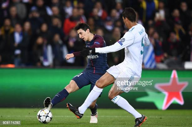 Paris SaintGermain's Argentinian forward Angel Di Maria vies for the ball with Real Madrid's French defender Raphael Varane during the UEFA Champions...