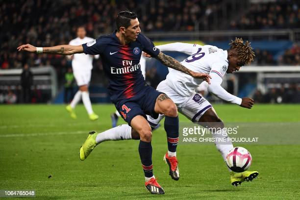 Paris SaintGermain's Argentinian forward Angel Di Maria vies with Toulouse's Swiss defender Jacques Francois Moubandje during the French L1 football...
