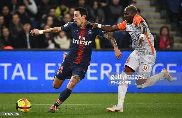 Paris SaintGermain's Argentinian forward Angel Di Maria vies with Montpellier's Cameroonian midfielder Ambroise Oyongo during the French L1 football...