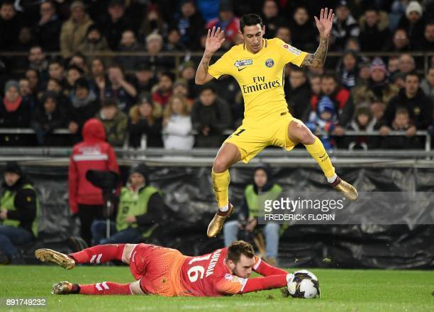 Paris Saint-Germain's Argentinian forward Angel Di Maria vies with Strasbourg's French goalkeeper Alexandre Oukidja during the French League Cup...