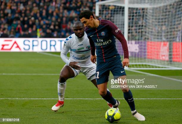 Paris SaintGermain's Argentinian forward Angel Di Maria vies with Strasbourg's French defender Ernest Seka during the French Ligue 1 football match...