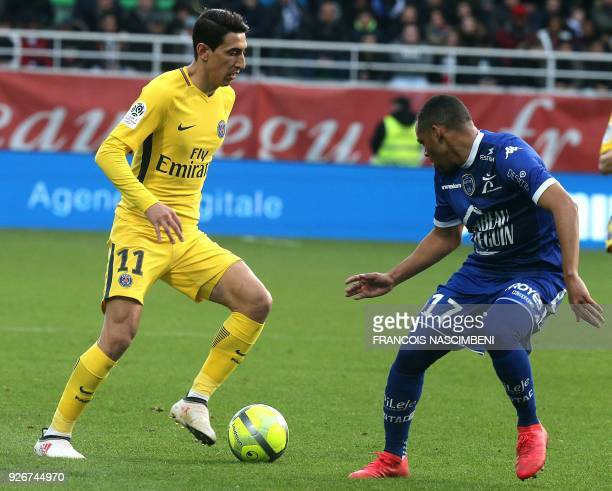 Paris SaintGermain's Argentinian forward Angel Di Maria vies with Troyes' defender Johann Obiang during the French L1 football match between Troyes...