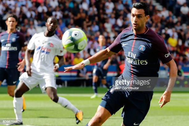 Paris SaintGermain's Argentinian forward Javier Pastore eyes the ball during the French L1 football match between Paris SaintGermain and Amiens SC on...