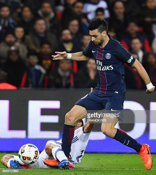 Paris SaintGermain's Argentinian forward Javier Pastore is tackled by Lyon's French defender Jeremy Morel during the French L1 football match Paris...