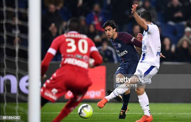 Paris SaintGermain's Argentinian forward Javier Pastore kicks the ball in front of Troyes' Malian goalkeeper Mamadou Samassa during the French L1...