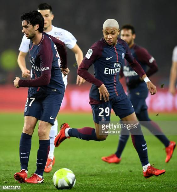 Paris SaintGermain's Argentinian forward Javier Pastore passes a ball to Paris SaintGermain's French forward Kylian MBappe during the French L1...