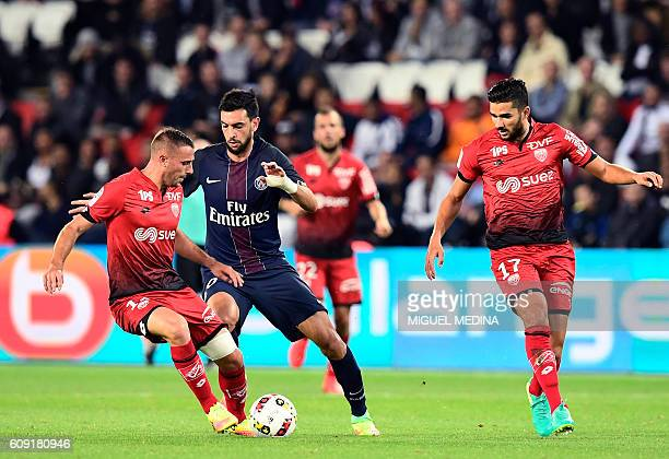 Paris SaintGermain's Argentinian forward Javier Pastore vies with Dijon's French midfielder Jordan Marie during the French L1 football match between...