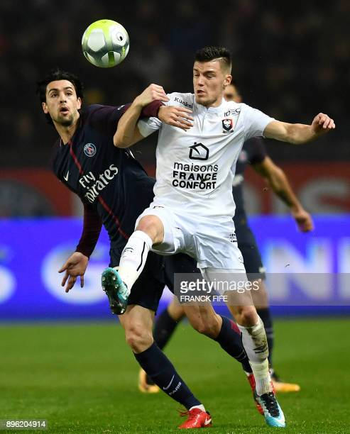 Paris SaintGermain's Argentinian forward Javier Pastore vies with Caen's French defender Frederic Guilbert during the French L1 football match...