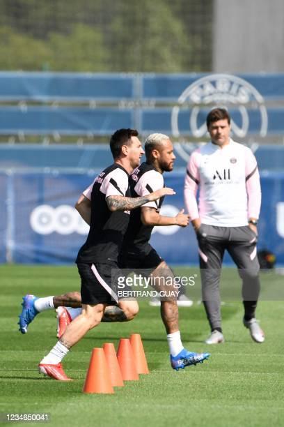 Paris Saint-Germain's Argentinian forward Lionel Messi , Paris Saint-Germain's Brazilian forward Neymar and Paris Saint-Germain's Argentinian head...