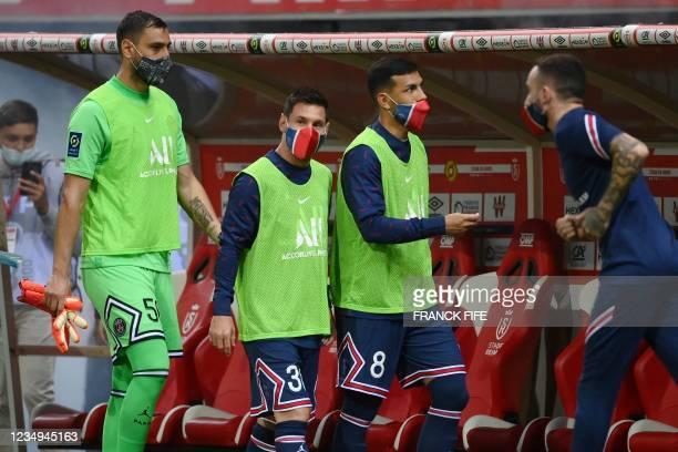 Paris Saint-Germain's Argentinian forward Lionel Messi , Paris Saint-Germain's Italian goalkeeper Gianluigi Donnarumma and Paris Saint-Germain's...