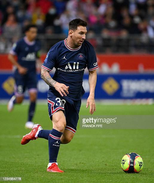 Paris Saint-Germain's Argentinian forward Lionel Messi plays the ball during the French L1 football match between Stade de Reims and Paris...