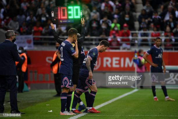 Paris Saint-Germain's Argentinian forward Lionel Messi runs on the pitch as a substitute during the French L1 football match between Stade de Reims...