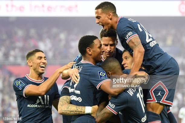 Paris Saint-Germain's Argentinian forward Mauro Icardi celebrates after scoring a goal with Paris Saint-Germain's Moroccan defender Achraf Hakimi,...