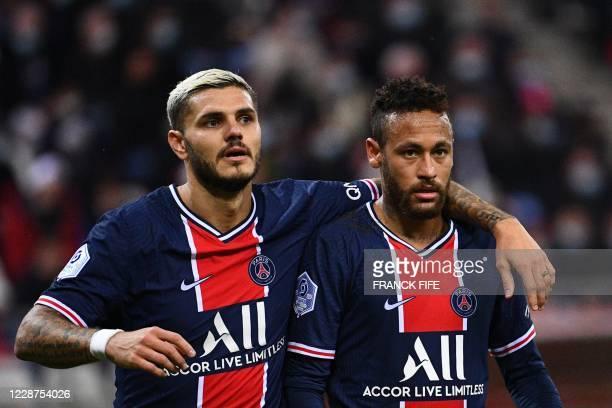Paris Saint-Germain's Argentinian forward Mauro Icardi celebrates with Paris Saint-Germain's Brazilian forward Neymar after scoring a goal during the...