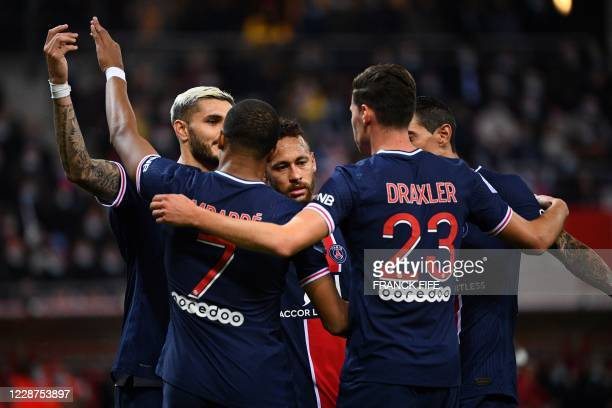 Paris Saint-Germain's Argentinian forward Mauro Icardi is congratulated by teammates after scoring a goal during the French L1 football match between...