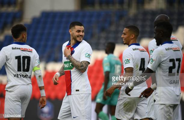 Paris Saint-Germain's Argentinian forward Mauro Icardi reacts with teammates after scoring his team's fourth goal during the French Cup quarter-final...