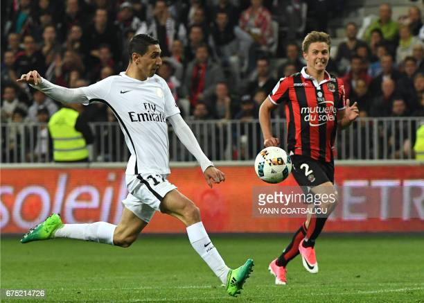 Paris SaintGermain's Argentinian midfielder Angel Di Maria outruns Nice's French defender Arnaud Souquet during the French L1 football match Nice vs...