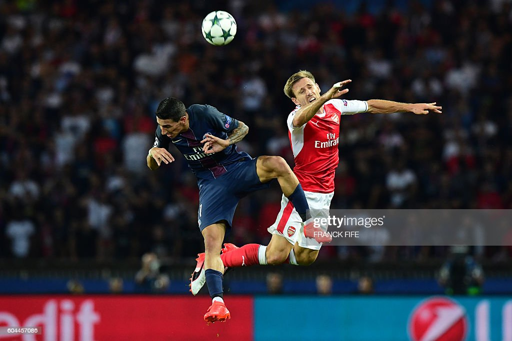 Paris Saint-Germain's Argentinian midfielder Angel Di Maria (L) vies with Arsenal's Spanish defender Nacho Monreal during the UEFA Champions League Group A football match between Paris-Saint-Germain vs Arsenal FC, on September 13, 2016 at the Parc des Princes stadium in Paris.