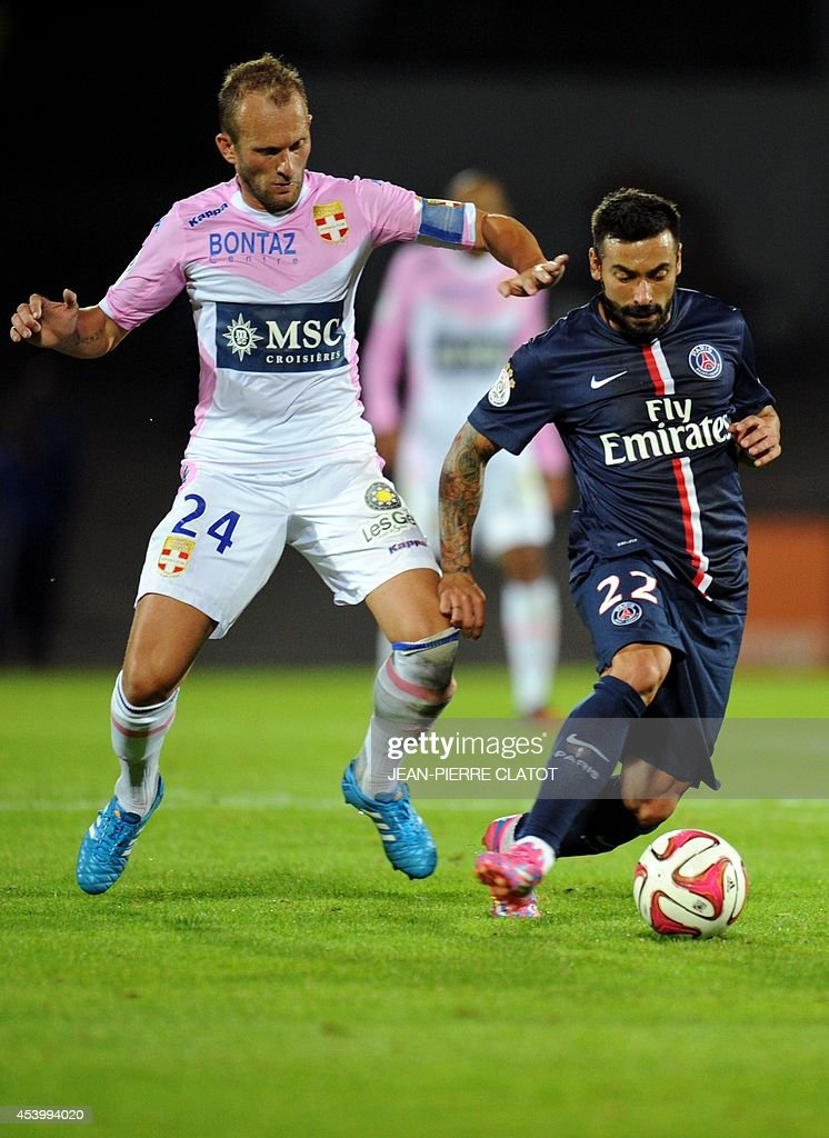 Paris Saint-Germain's Argentinian midfielder Ezequiel Lacezzi (R) vies with Evian's French midfielder Olivier Sorlin during the French L1 football match between Evian Thonon Gaillard (ETGFC) and Paris Saint-Germain (PSG) on August 22, 2014 at the Parc des Sport in Annecy, southeastern France.
