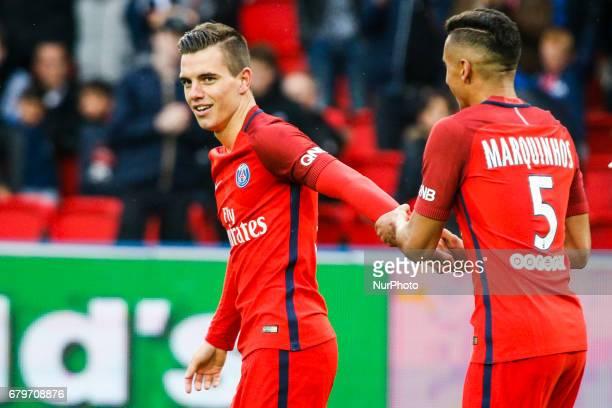 Paris SaintGermain's Argentinian midfielder Giovani Lo Celso is congratuled by teammate Paris SaintGermain's Brazilian defender Marquinhos after...