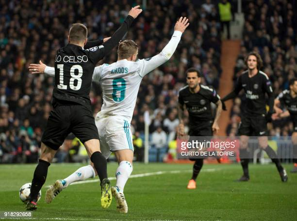 Paris SaintGermain's Argentinian midfielder Giovani Lo Celso tackles Real Madrid's German midfielder Toni Kroos leading to a penalty during the UEFA...