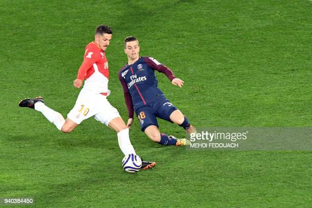 Paris SaintGermain's Argentinian midfielder Giovanni Lo Celso tackles Monaco's forward Stevan Jovetic during the French League Cup final football...
