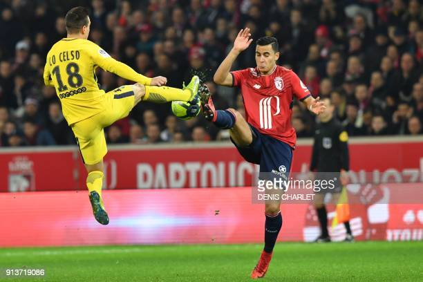 Paris SaintGermain's Argentinian midfielder Giovanni Lo Celso vies with Lille's DutchMorrocan forward Anwar ElGhazi during French L1 football match...