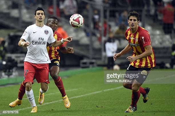 Paris SaintGermain's Argentinian midfielder Javier pastore and Lens' Argentinian forward Pablo Chavarria eye the ball during the French L1 football...