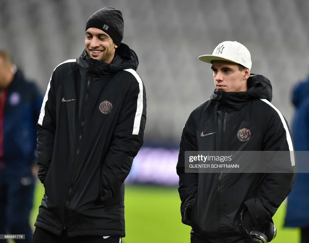 Paris Saint-Germain's Argentinian midfielder Javier Pastore (L) and Paris Saint-Germain's Argentinian midfielder Giovani Lo Celso (R) walk on the pitch one day ahead of the UEFA Champions League Group B match between FC Bayern Munich vs PSG Paris, at the Allianz Arena in Munich, southern Germany, on December 4, 2017. /