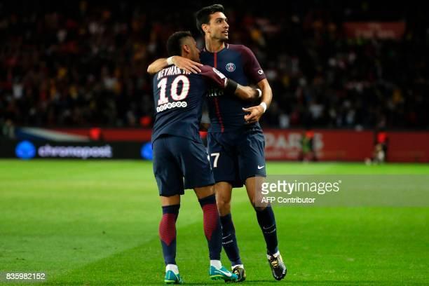 Paris SaintGermain's Argentinian midfielder Javier Pastore celebrates after scoring a goal with Paris SaintGermain's Brazilian forward Neymar during...