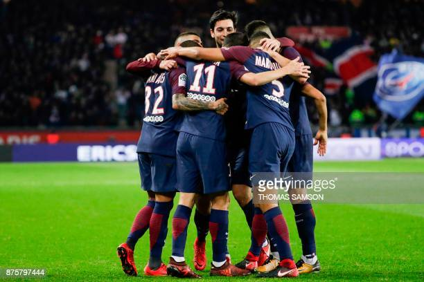 Paris SaintGermain's Argentinian midfielder Javier Pastore celebrates with teammates after his team's second goal during the French L1 football match...