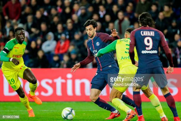 Paris SaintGermain's Argentinian midfielder Javier Pastore dribbles Nantes' Brazilian defender Diego Carlos during the French L1 football match...