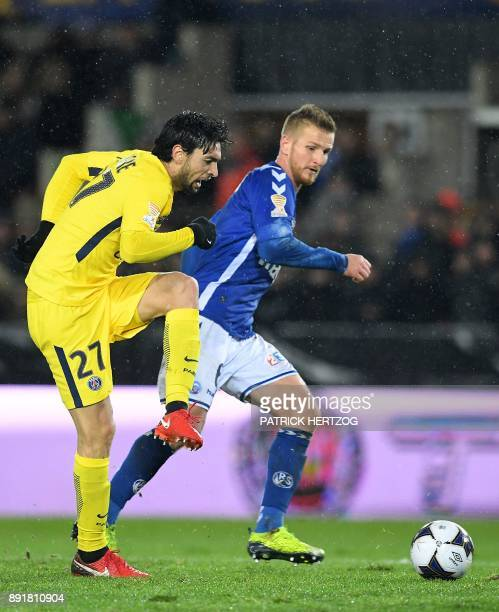 Paris SaintGermain's Argentinian midfielder Javier Pastore kicks the ball next to Strasbourg's French midfielder Jeremy Grimm during the French...