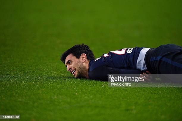 Paris SaintGermain's Argentinian midfielder Javier Pastore lies on the field during the French L1 football match between Paris SaintGermain and...