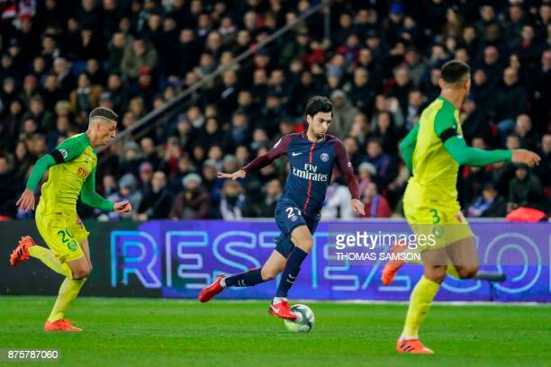 Paris SaintGermain's Argentinian midfielder Javier Pastore makes his way through Nantes' Brazilian midfielder Andrei Girotto and Nantes' Brazilian...