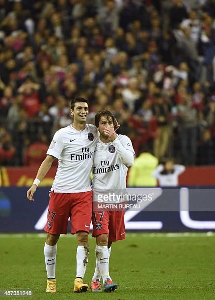 Paris SaintGermain's Argentinian midfielder Javier pastore congratulates Paris SaintGermain's Brazilian defender Maxwell after he scored a goal...