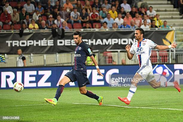Paris SaintGermain's Argentinian midfielder Javier Pastore scores the first goal next to Lyon's French defender Jeremy Morel during the French...