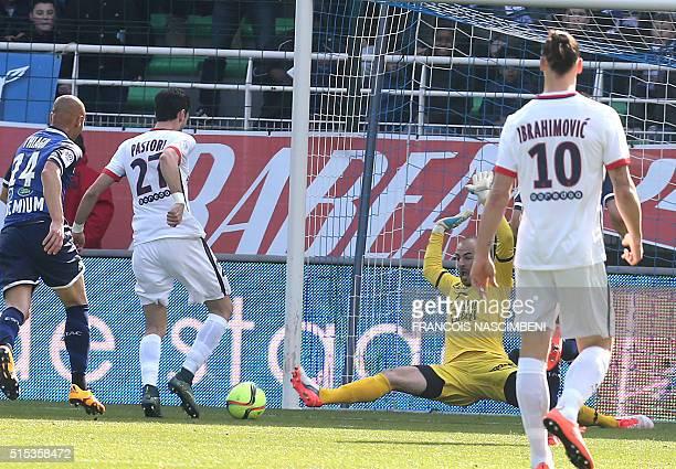 Paris SaintGermain's Argentinian midfielder Javier Pastore shoots to score his side's second goal past Troyes' French Goalkeeper Matthieu Dreyer...