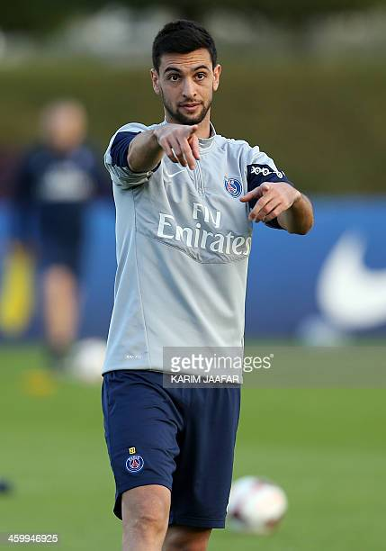 Paris SaintGermain's Argentinian midfielder Javier Pastore takes part in a training session at the Aspire Academy of Sports Excellence in the Qatari...