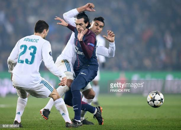 Paris SaintGermain's Argentinian midfielder Javier Pastore vies for the ball with Real Madrid's Croatian midfielder Mateo Kovacic and Real Madrid's...