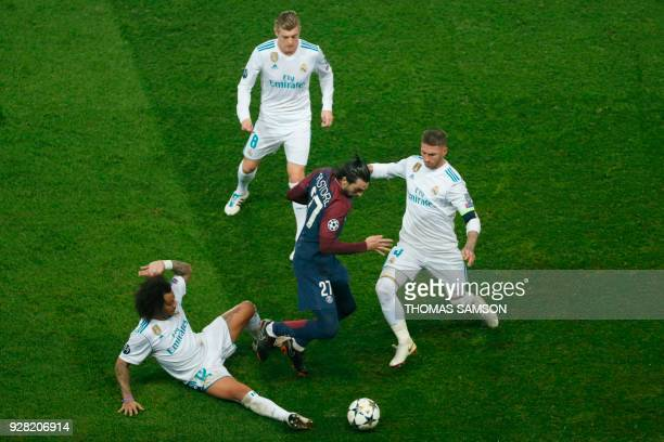 Paris SaintGermain's Argentinian midfielder Javier Pastore vies for the ball with Real Madrid's Brazilian defender Marcelo and Real Madrid's Spanish...