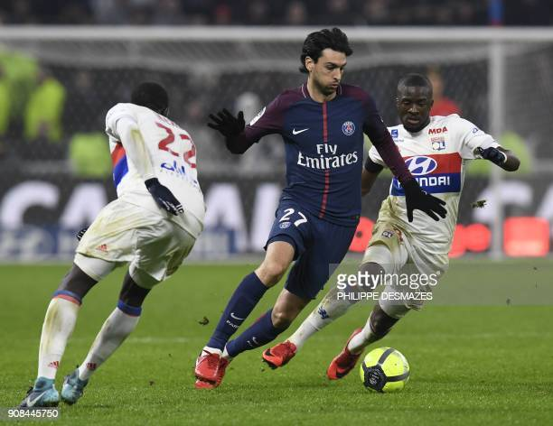 Paris SaintGermain's Argentinian midfielder Javier Pastore vies with Lyon's French defender Ferland Mendy and Lyon's French midfielder Tanguy...