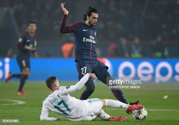 Paris SaintGermain's Argentinian midfielder Javier Pastore vies with Real Madrid's Spanish midfielder Lucas Vazquez during the UEFA Champions League...