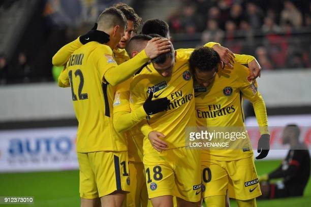 Paris Saint-Germain's Argentinian midfielder Paris Saint-Germain's Argentinian midfielder Giovanni Lo Celso celebrates with teammates after scoring a...