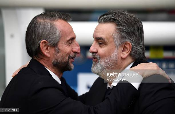Paris SaintGermain's assistant general manager Jean Claude Blanc speaks with Montpellier's French club president Laurent Nicollin during the French...