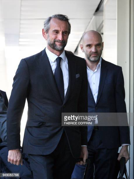 Paris SaintGermain's assistant general manager JeanClaude Blanc and secretary general Victoriano Melero arrive with a delegation to a hearing on UEFA...