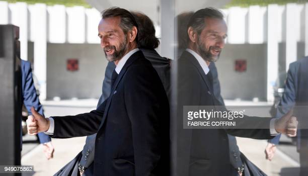 Paris SaintGermain's assistant general manager JeanClaude Blanc gives a thumb up after a hearing on UEFA Financial Fair Play Regulations at the House...