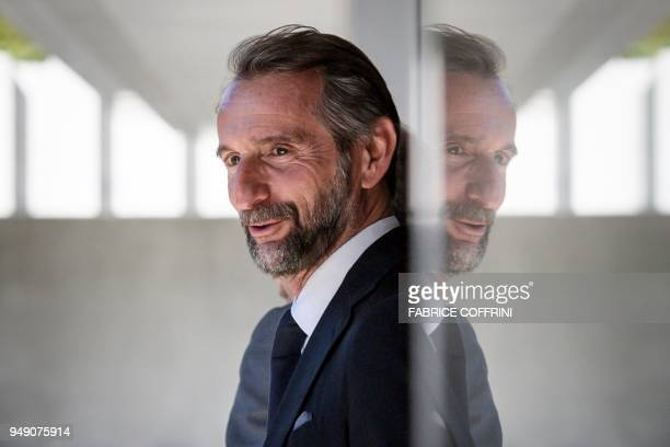 Paris SaintGermain's assistant general manager JeanClaude Blanc leaves after a hearing on UEFA Financial Fair Play Regulations at the House of...